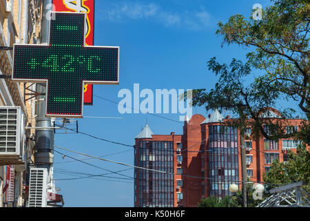 Thermometer on summer heat in city - Stock Photo