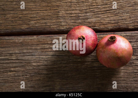Close-up of pomegranates on a wooden table - Stock Photo