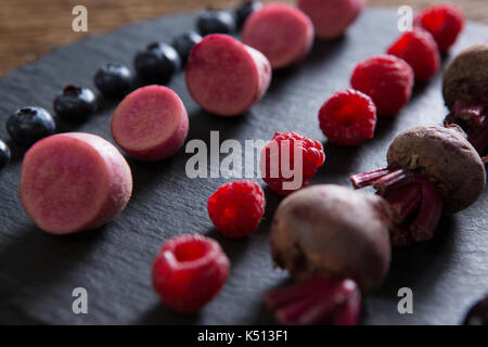 Close-up of fruits and vegetables on chopping board - Stock Photo