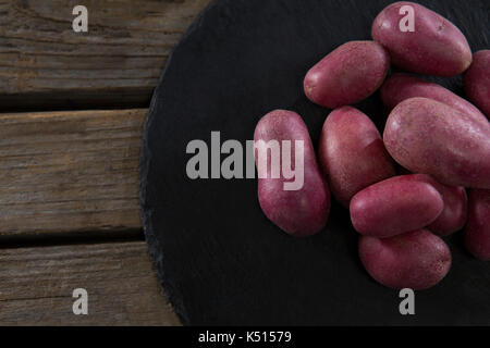 Close-up of sweet potatoes in a tray - Stock Photo