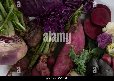 Close-up of various vegetables on white background - Stock Photo