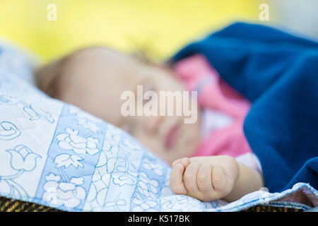 One year old baby girl peacefully sleeping in the nature - Stock Photo