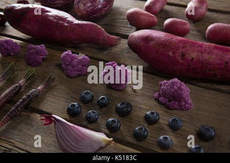 Close-up of various vegetable arranged on wooden table - Stock Photo