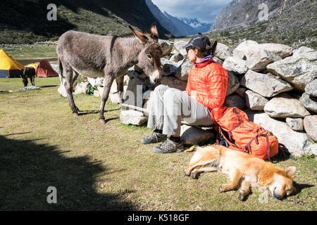 Having a break from trekking in Santa Cruz valley, Cordillera Blanca, Peru - Stock Photo
