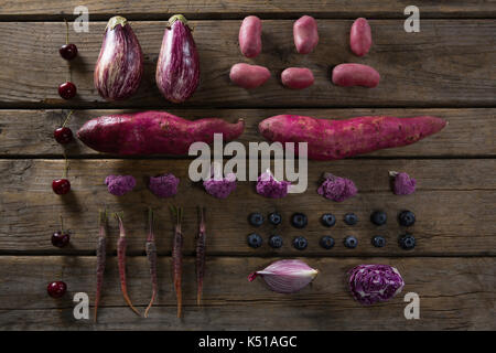 Overhead view of various vegetable arranged on wooden table - Stock Photo