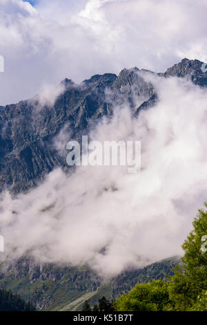 AROLLA, SWITZERLAND - Clouds and mountain landscape, in Pennine Alps. - Stock Photo