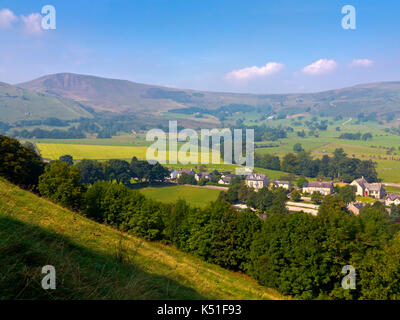View looking towards Mam Tor from Castleton in the Derbyshire Peak District England UK in summer. - Stock Photo