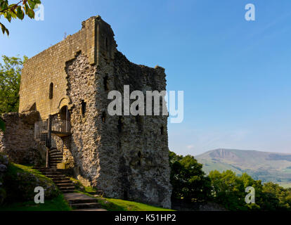 Peveril Castle a ruined 11th century castle overlooking the village of Castleton in the Derbyshire Peak District - Stock Photo