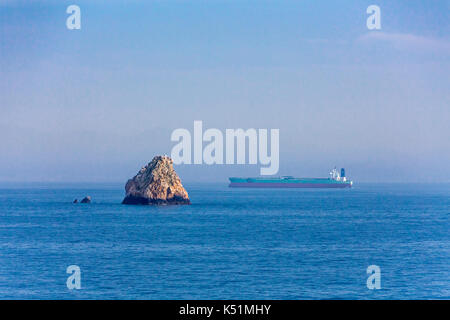An ocean going cargo ship in the South China Seas, Asia. - Stock Photo