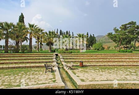 Pathwalk near the pool in Pamukkale resort, Turkey - Stock Photo
