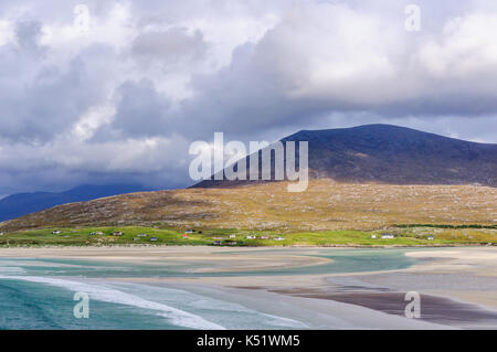 Luskentyre on the Isle of Harris, Scotland, a stormy day with clouds in the sky, outgoing tide from a sandy beach - Stock Photo