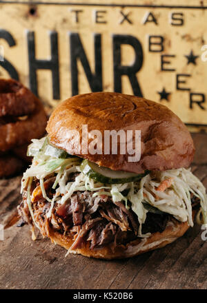 BBQ Pulled Pork Sandwich with bleu cheese slaw and dill pickles, Texas Style - Stock Photo