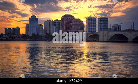 Dramatic sunset sky behind the skyline of West Palm Beach, Florida - Stock Photo