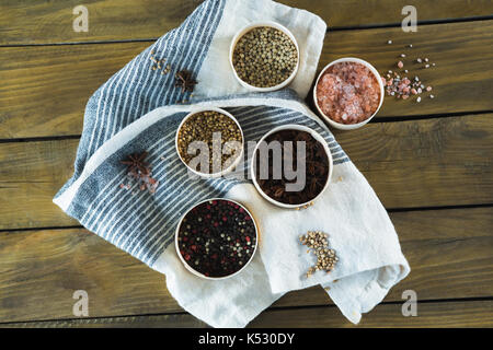 Various type spices in bowl on wooden table - Stock Photo