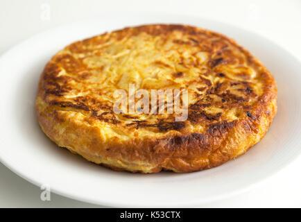 Tortilla de patatas, a spanish omelette, typical spanish dish. - Stock Photo