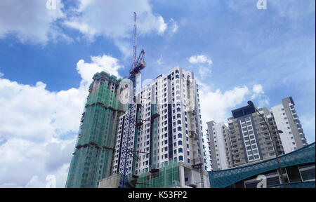 High rise building under construction in Malaysia. - Stock Photo