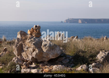 Sagres, Portugal: Stone cairns overlooking Cape St. Vincent from the Fortress of Sagres. The cape is the southwestern - Stock Photo