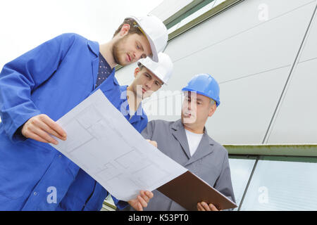 adult with teenagers in professional training - Stock Photo