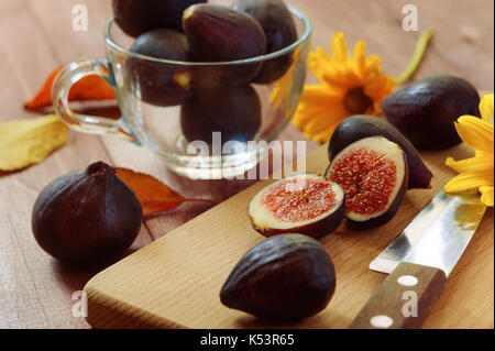 Bright autumn composition of figs, dry flowers and tree branches on wood background. Flat lay, top view - Stock Photo