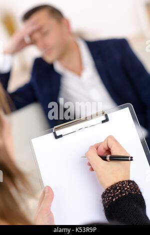photo of professional female counselor helping depressed man - Stock Photo
