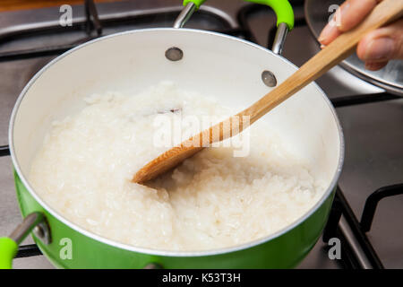 Rice Pudding with cinamon and raisins preparation : Rice preparation - Stock Photo