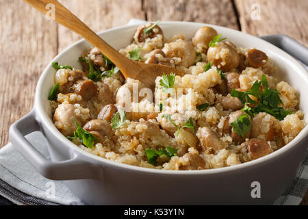 Vegetarian Food: Quinoa with mushrooms and onion closeup in a pot on the table. horizontal - Stock Photo
