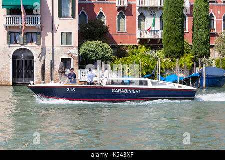 Carabinieri in their boat on the Grand Canal, Venice, Italy. The Carabinieri  have a dual role and are both Military - Stock Photo