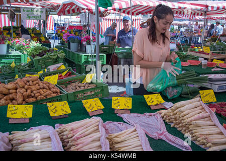Market stalls selling fresh produce in the Hauptmarkt or market square, Nuremberg, Bavaria, Germany - Stock Photo