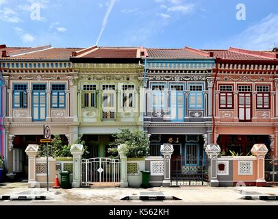 A row of four traditional Singapore Peranakan shop houses in the historic Joo Chiat area. - Stock Photo