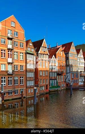 Historic houses at Nikolaifleet in Hamburg - Stock Photo