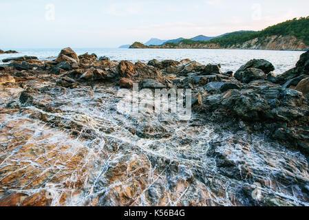 Huge rocks, cliffs and rocks along the coast. - Stock Photo