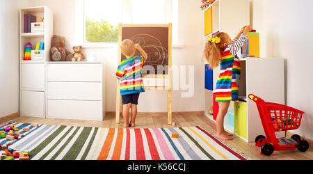 little child drawing on the blackboard - Stock Photo