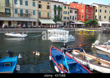 Lazise, Lake Garda, Italy boats in the resort lakeside harbour - Stock Photo