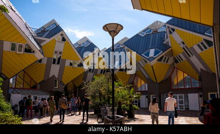 ROTTERDAM, NETHERLANDS - AUGUST 13, 2017 : Group of tourists in the yard of Cube houses or Kubuswoningen in Dutch - Stock Photo