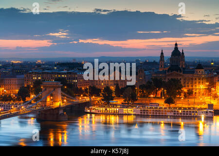 View of the Chain Bridge and St. Stephen's Basilica in Budapest. - Stock Photo