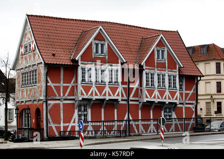 Red wooden Fachwerk house in the old Wismar - Stock Photo