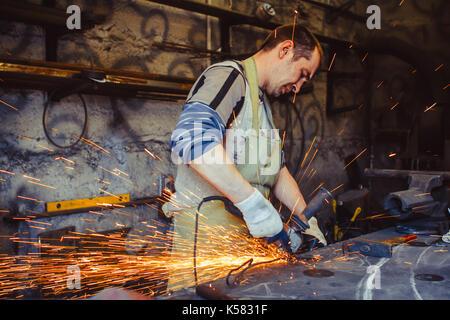 Working saws iron sparks - Stock Photo