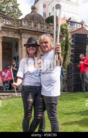 Portmeirion, Wales, UK. 8th September, 2017. Mike Peters of The Alarm leads the Commonwealth Games Baton parade - Stock Photo