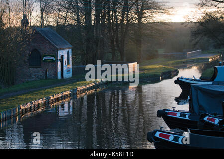 Berthed Narrow boats on The Staffordshire and Worcestershire Canal at Sunset, Great Haywood Junction, Staffordshire, - Stock Photo