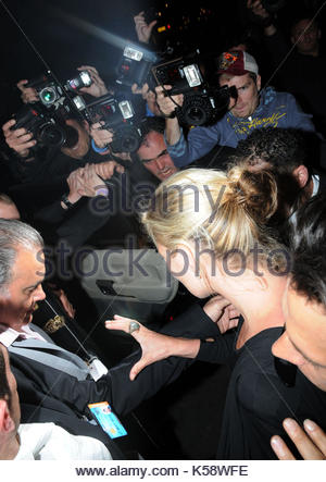 Kate Moss. Kate Moss is met by photograhers as she leaves Cafe De Paris at 3.30am after taking part in a talent - Stock Photo