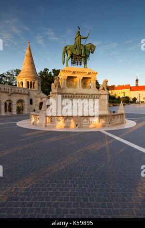Morning view of Fisherman's Bastion and St. Stephen's statue in historic city centre of Buda, Hungary. - Stock Photo