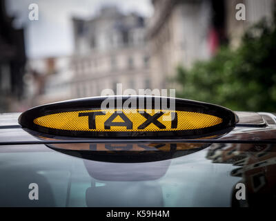 Mercedes Vito London Taxi Black Cab - Signs on a Mercedes Vito Taxi in central London. The Vito is an alternative - Stock Photo