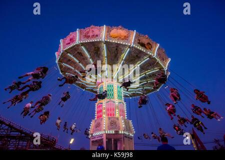 Wave Swinger ride at Playland Amusement Park, Vancouver, British Columbia, Canada. - Stock Photo