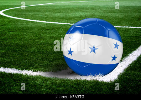 High quality render of soccer ball ready to shoot at at soccer field on green grasses. 3D rendering. - Stock Photo