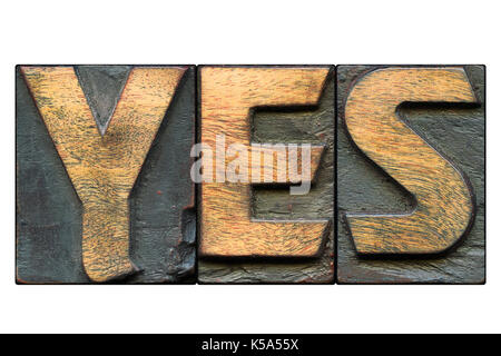 yes word made from vintage bold letterpress blocks isolated on white - Stock Photo