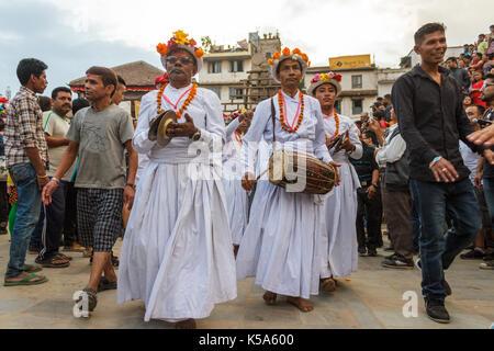 KATHMANDU, NEPAL - 9/26/2015: Musical performers walk through the crowd during the Indra Jatra festival at Durbar - Stock Photo