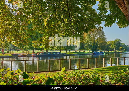 Stratford upon Avon an early morning autumn reflections on the River Avon, with narrow boats moored near the old - Stock Photo