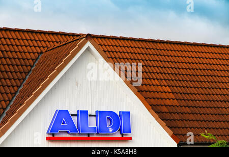 TEMPLIN, GERMANY - AUG 31, 2017: Detail on the façade at ALDI discount supermarket in Templin, Uckermark district - Stock Photo