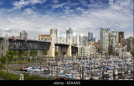 View of Burrard Bridge, Fisherman Wharf and Marina from False Creek Seawall near Kitsilano Vancouver British Columbia - Stock Photo