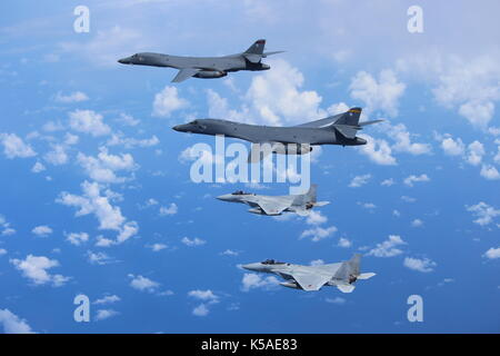 Two U.S. Air Force B-1B Lancers fly a bilateral mission with two Koku Jieitai (Japan Air Self-Defense Force) F-15s - Stock Photo